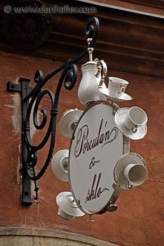 One of my favorite signs of all time. Great for a tea or coffee house or garden setting too.: