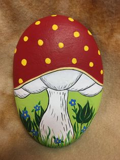 "Mushroom hand painted 4"" stone. Goes all the way around."