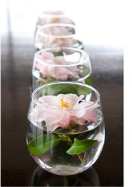 centerpiece ideas - Google Search  Vases from dollar store? Flower of choice? Dye the water? Couple per table?