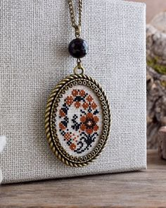 Ochre and black flowers embroidered necklace Floral necklace Cross stitch necklace Flowers hand embroidery pendant Textile jewelry Cross Stitch Bookmarks, Cross Stitch Embroidery, Hand Embroidery, Black Flowers, Floral Flowers, Wedding Cross Stitch, Floral Embroidery Patterns, Cross Jewelry, Hand Jewelry