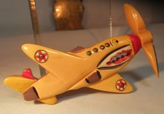 super rare patriotic Bakelite Fighter Plane design pin with spinning propellor - measures 3-1/2""
