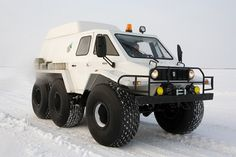 A All terrain 6x6.  Trecol, a 6 wheel all terrain vehicle, on the frozen River Northwest Siberia, Russia