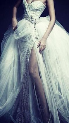 Sexy wedding dress. Plunge neck line Love the allure.