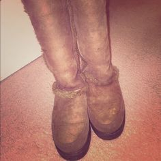 Ugg boots! Priced to sell!!! Boot a of shoes hardly worn! Worn 3 times!!! Only flaw is the back of the heel, rubber came off and slight spotting for the rain! Can be sprayed and treated to keep weatherized!! I bought there for $189 on sale! They come up just above mid calf ! Women's size 7 can fit 71/2. Awesome fur shearling lining color is a brown taupe color!! UGG Shoes Winter & Rain Boots