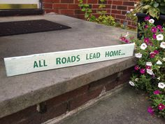 "Small wood sign with the quote ""All Roads Lead Home"" on Etsy, $20.00"