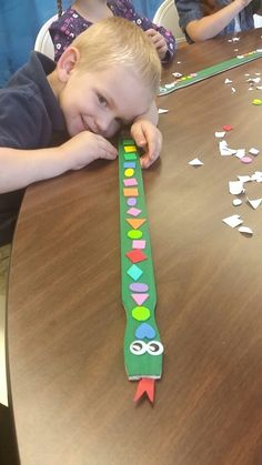 Snake/Rod - one side is green. The other is brown. The kids decorated the snake. Theme: Moses' rod that turned to a snake. Use paint stir sticks