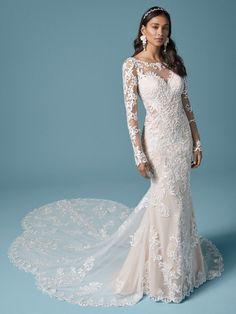 Lydia Anne| Elegant lace sheath wedding dress with long scalloped train. #wedding #weddingdress #weddingdresses #bride #bridal #bridalgown #weddingplanning #weddingfashion #maggiesottero