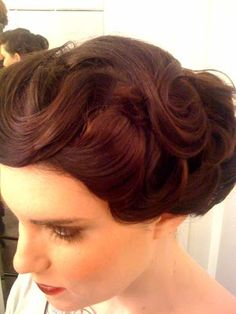 Pinup hairstyle for short hair.