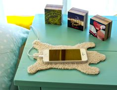 The Snoozz, vegan friendly smartphone rest. Seen here with Plywerk's mini photo cubes. Made in Portland!