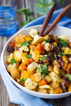 Roasted butternut and acorn squash, parsnips and turnips fill out a colorful and filling gluten-free winter panzanella salad.