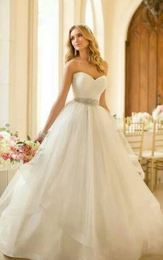 This is the type of dress that I might have at my wedding, but it needs lace.