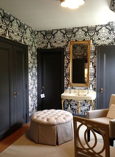 Clarence House the Vase wallpapered bathroom + brass hardware + charcoal doors