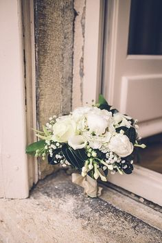 White and gold wedding bouquet | Image By Amy Faith Photography