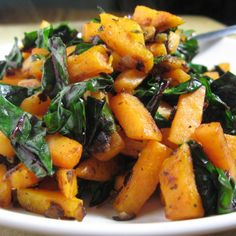 Sweet Potato & Swiss Chard Sauté  2 T. coconut oil 1/2 small yellow onion, minced 1 small sweet potato, peeled and diced 1 t. seasoning blend (I used Penzey's Sandwich Sprinkle) 1 bunch Swiss chard, cut off the stalk, cleaned, and roughly chopped salt and pepper to taste