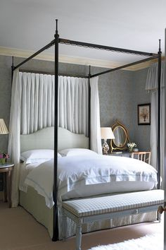 """The four-poster bed in the main bedroom was comissioned by Sibyl Colefax & John Fowler.  Like this? Then you'll love  [link url=""""http://www.houseandgarden.co.uk/interiors/bedroom""""]The House & Garden Bedroom Archive[/link]"""