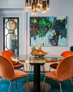 """112 Likes, 8 Comments - Michelle Matangi (@michellematangi) on Instagram: """"Dining room magic!!! Oh how I love bold art, orange and gold, round tables and statement lighting…"""""""