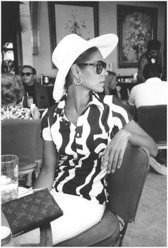 A young woman at the Palm Bay Club, Miami, Florida, USA, circa 1965,photo Slim Aarons
