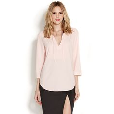 This easy top looks feminine and polished while feeling perfectly relaxed. A tie neck design and gathered details at the yoke add a sweet touch.