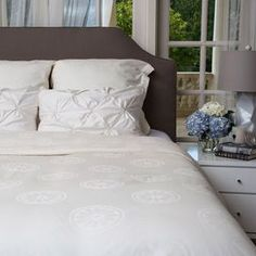 Three-piece 100% cotton jacquard bedding set with citrus-inspired medallion motif. Includes one duvet and two shams.   Product: Full/Queen: 1 Duvet cover and 2 standard shams  King/California King: 1 Duvet cover and 2 Euro shams Construction Material: 100% Cotton sateenColor:  CreamFeatures:  350 Thread countJacquard designDuvet zipper enclosure Interior corner tiesNote: Shams do not include insertsCleaning and Care: Machine wash cold