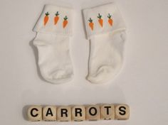 Tiny socks with little painted carrots on them  Seem to be made of nylon and are super soft  Great for Easter or for any occasion Infant size, 0