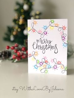 Handmade Christmas cards with Christmas lights and calligraphy. You can purchase them on Etsy at the link below! : Handmade Christmas cards with Christmas lights and calligraphy. You can purchase them on Etsy at the link below!