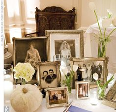 LOVE THIS  At the reception, family photos were displayed in antique picture frames.