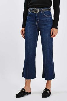 Keep denim looking current with the MOTO cropped wide leg jeans. Crafted from a super-soft rigid cotton denim in a high-rise fit, they come with raw hem detail, multiple pockets and a zip fly to fasten. Style back with a simple shirt and this season's essential glove shoe to finish the look. #Topshop
