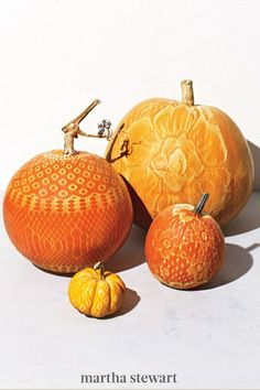 Don't feel like carving a pumpkin? Use a pair of lacy stockings and a can of spray paint to decorate a patch of pumpkins with instant, intricate designs in a matter of minutes. #marthastewart #halloween #halloweendecor #diyideas #diyhalloween #halloweenlivingroom