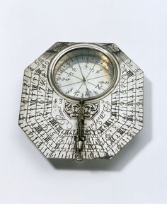 """1680-1699 French Sundial at the Victoria and Albert Museum, London - From the curators' comments: """"The geographical latitudes of 30 towns, mostly French, are engraved on he back of this sundial. With the inbuilt compass, they helped the traveller to position the sundial, so that he or she could more accurately discover the time of day....A German travellers' guide of the time recommended the use of sundials over clocks, because the chiming of clocks might attract thieves."""""""