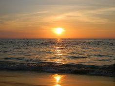 Sunset at Caron Beach in Phuket, Thailand