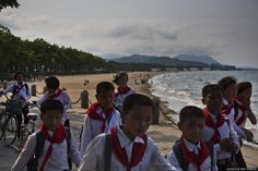 In this June 15, 2014 photo, North Korean school children walk on the beach next to the sea in the east coast city of Wonsan in North Korea's Kangwon province. (AP Photo/David Guttenfelder)