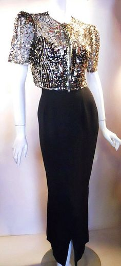 silk 40s gown with sheer black mesh jacket loaded with golden gelatin rhinestones.  I am in love