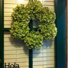 "Hydrangea wreath. 8 silk hydrangea stems from michael's during their half off sale. 14"" grape vine leaf.   I love it!"