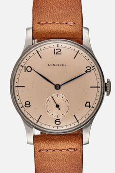 Updated with a Hodinkee faded brown calfskin strap, this vintage Longines Calatrava watch from the 1940s is in great working order considering it's about 70 years old.