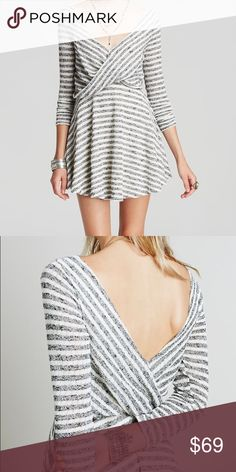 NWT Free People Stripe Dress Soft and airy dress features allover stripes for a a classic look.  Surplice neckline and three-quarter length sleeves. Deep V-back. Nipped waist. Pull-on design. Flared hemline falls at a flirty length. Fully lined. 62% polyester, 38% cotton; Lining: 100% rayon. Machine wash cold, tumble dry low. Imported. Measurements: Length: 32 in Free People Dresses
