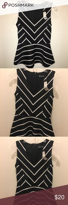 NEW YORK & Co - Striped peplum top. NWT. Statement top! Dressy attire, appropriate for an evening out.  Very cute and material is soft to the touch. Label says XS, but it is 5% spandex so it will fit a small comfortably. New York & Company Tops Blouses