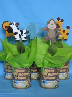 Jungle baby shower centerpeice.. Amber how easy would these be? Wrap a soup can in paper?