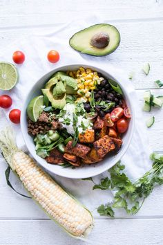 Sweet Potato Taco Bowl with a white background and additional ingredients styled.