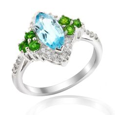 Colorful, glittering and joyful, these are some of the words which describe this ring. Made from 925 Sterling Silver and plated with a special layer of Rhodium, the ring is the accessory for occasions where a little show is required. The main stone used here is a Marquis cut Blue Topaz, surrounded by Green Peridots and Cubic Zirconia.