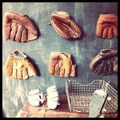 love this display of vintage baseball gloves