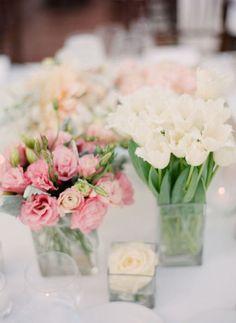 simple centerpieces in square vases (roses, tulips)