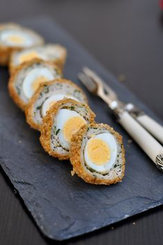 Quail Scotch Eggs.  Would remix with a chicken egg. I like the idea of a hardboiled egg in sausage.