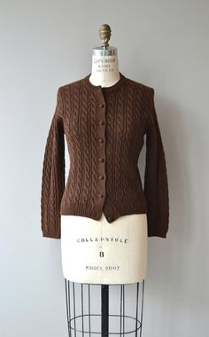 Vintage 1950s chocolate brown wool cable knit cardigan with lovely knit buttons. --- M E A S U R E M E N T S --- fits like: small shoulder: 16 bust: 32-37 sleeve: 22 length: 22 brand/maker: Austin Hill | 100% virgin wool condition: excellent ➸ More tops & sweaters https://www.etsy.com/shop/DearGoldenVintage?section_id=5800171 ➸ Visit the shop http://www.DearGolden.etsy.com _____________________ ➸ instagram | deargolden ➸ twitter | deargolden ➸ f...