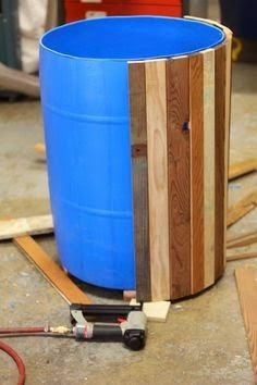 Great idea!! DIY faux wooden barrel using pallet slats