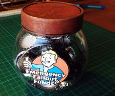 I've put together a simple project to make your own emergency Fallout piggy bank.In the Fallout video game series, bottle caps are used as currency. What better way to insure survival in the event of nuclear fallout than to make you own emergency bottle cap piggy bank saver!This project is really simple to make. Things you will need; Glass or plastic jar/container with lid. Bottle caps, can be found at local bars. The FPSXGames printable template. Templates can be found here; http:&#...