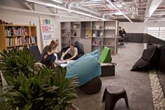 The new BrandOpus office - big bean bags, open shelving, small stools and plants