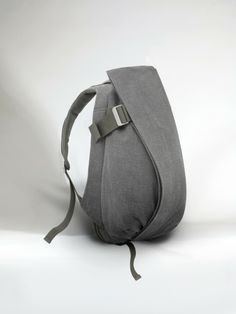 "Our Isar Rucksack is an ergonomic backpack built for creatives and entrepreneurs on the move. A conceptual design ensures fast, easy access to your laptop and office essentials, with ample space and the comfort you need for even the busiest days.  The laptop compartment accommodates up to laptops in size 13""/15"" (Medium) or 15""/17"" (Large)  This new fabric is rough to the touch, a matte, raw canvas that offers a different and unexpected tactility. Icelandic ash reflects the sky, an ash…"