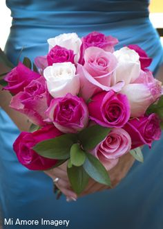 Pale and dark pink, along with white roses for the bridesmaid bouquet