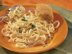Fettuccine Alfredo - I made this tonight for supper. I doubled the recipe and used Penne pasta and added chicken. I also added a dash of garlic powder and a little bit of milk because it was really thick. The kids LOVED IT! Quick and easy too!