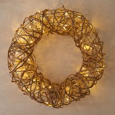 "Add a warm glow to indoor spaces with this rustic wreath of rattan vine, each one illuminated by an interwoven strand of twinkling LED lights.- Rattan, iron, PVC, copper, LED lights- Indoor use only- UL approved- Plug-in- Hanging hardware required- 4.9'L lead- Imported4.7""D, 19.7"" diameter"